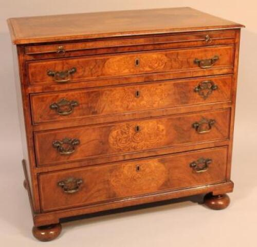 An 18thC and later walnut and inlaid chest of drawers