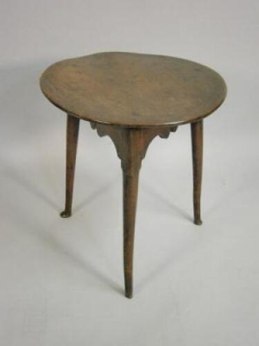 An 18th Century elm cricket table