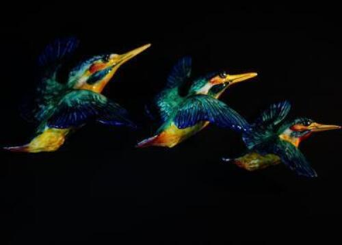 A set of three Beswick flying kingfishers