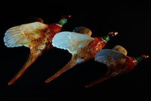 A set of three Beswick flying pheasants