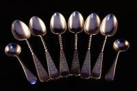A silver honey spoon