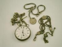 A silver pocket watch and various chains