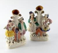 A pair of 19thC Staffordshire flat back spill vases