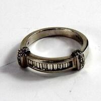 A platinum and diamond set ring