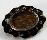 A Victorian enamelled memorial brooch