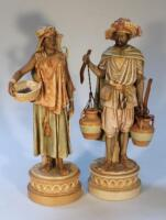 A pair of Royal Dux figures of Arabian water carriers