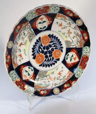 A late 19thC Japanese Imari pottery charger