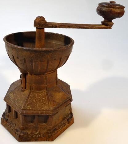 A late 19thC Christopher Dresser design cast iron coffee grinder