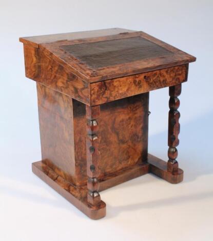 An early 20thC burr walnut veneered apprentice Davenport desk