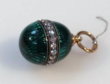 A green enamel egg shaped pendant