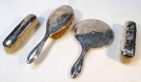 A harlequin Edwardian silver dressing table set
