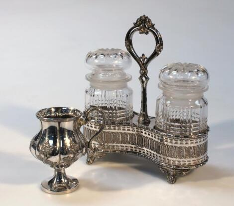 An Edwardian silver plated and glass jar set