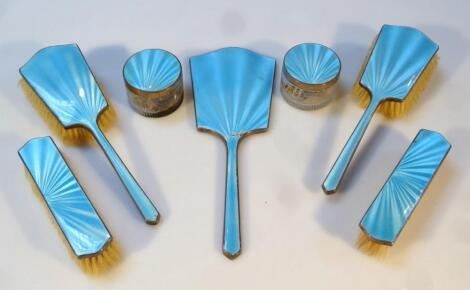 An Art Deco George VI blue enamel silver and glass dressing table set