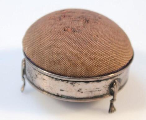An Edwardian silver and material pin cushion