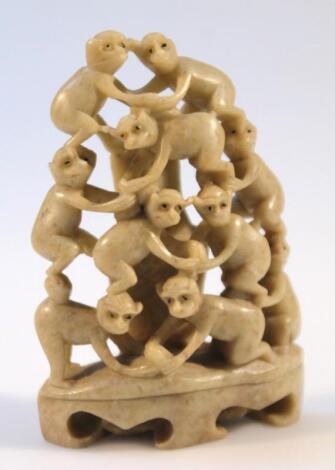 A 20thC polished soapstone figure group