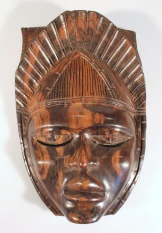 A 20thC African tribal hardwood face mask