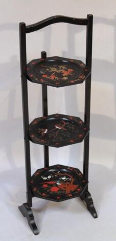 A black lacquer three sectional cake stand