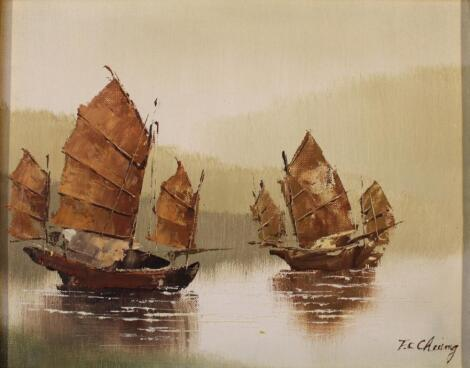 F C Chung (20thC Chinese School). Junks on calm water