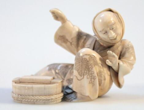 A 19thC Japanese ivory okimono figure
