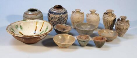 Various Chinese and Cambodian terracotta and part glazed earthenware