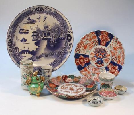 Various 19thC and later Chinese and Japanese earthenware chargers and plates