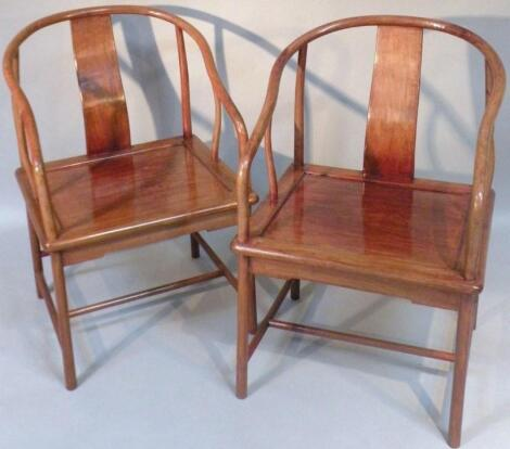 A pair of 20thC Chinese hardwood armchairs