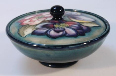 A mid-20thC Moorcroft Clematis pattern powder bowl and cover
