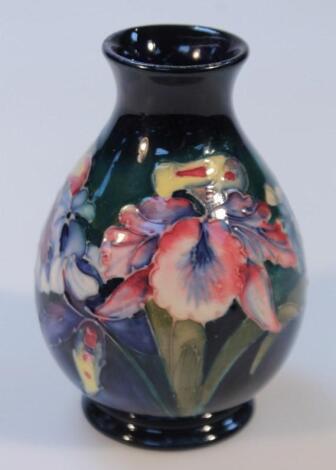 A 20thC Moorcroft Orchid pattern vase