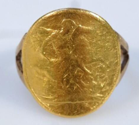 A 1958 gold sovereign curved ring