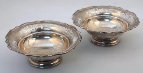 A pair of George VI Harrods silver bon bon dishes
