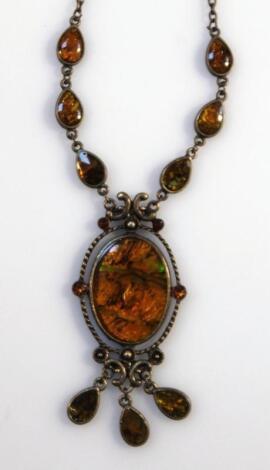 An Art Nouveau design amber finish pendant