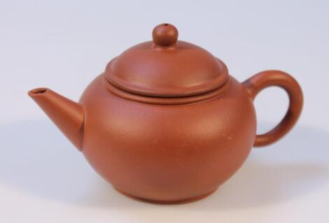 A Chinese redware pottery teapot