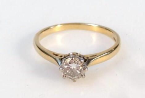 A ladies diamond solitaire ring