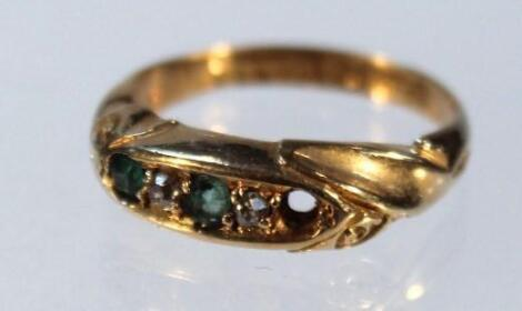 An 18ct emerald and diamond ring