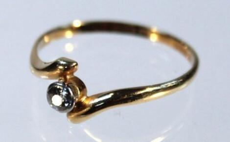 A diamond cross over solitaire ring