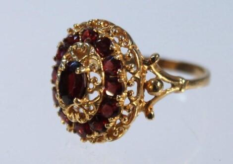 A garnet oval cluster ring