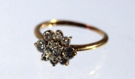 A ladies diamond nine stone cluster ring