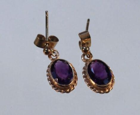 A pair of drop earrings