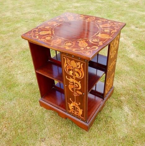 An Art Nouveau mahogany and marquetry revolving book stand