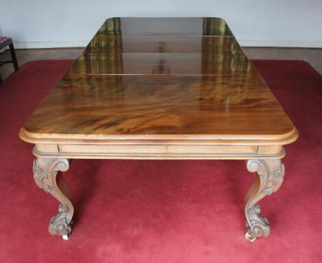 A Victorian figured mahogany extending dining table