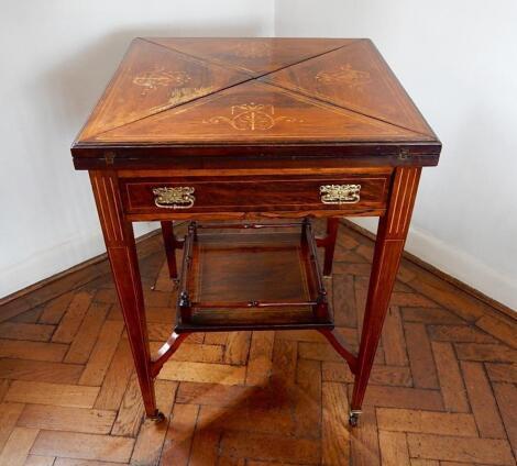 An Edwardian inlaid rosewood envelope top card table