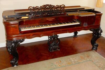 A late 19thC table piano by Steinway and Sons of New York