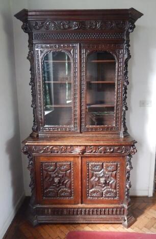 A Victorian carved oak bookcase