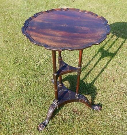 A Chippendale style mahogany circular table