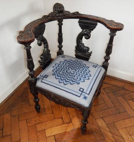 A Victorian carved oak corner chair