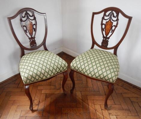 A pair of late Victorian inlaid mahogany single chairs