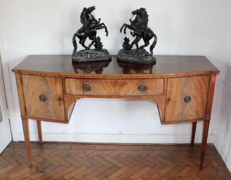 A George III figured mahogany sideboard