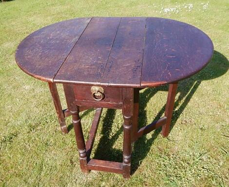 A small 18thC oak oval gateleg table