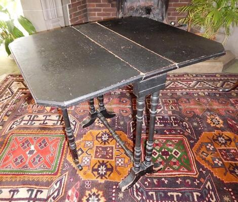 A Victorian ebonised Sutherland table