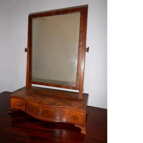 A George III inlaid mahogany serpentine front toilet mirror
